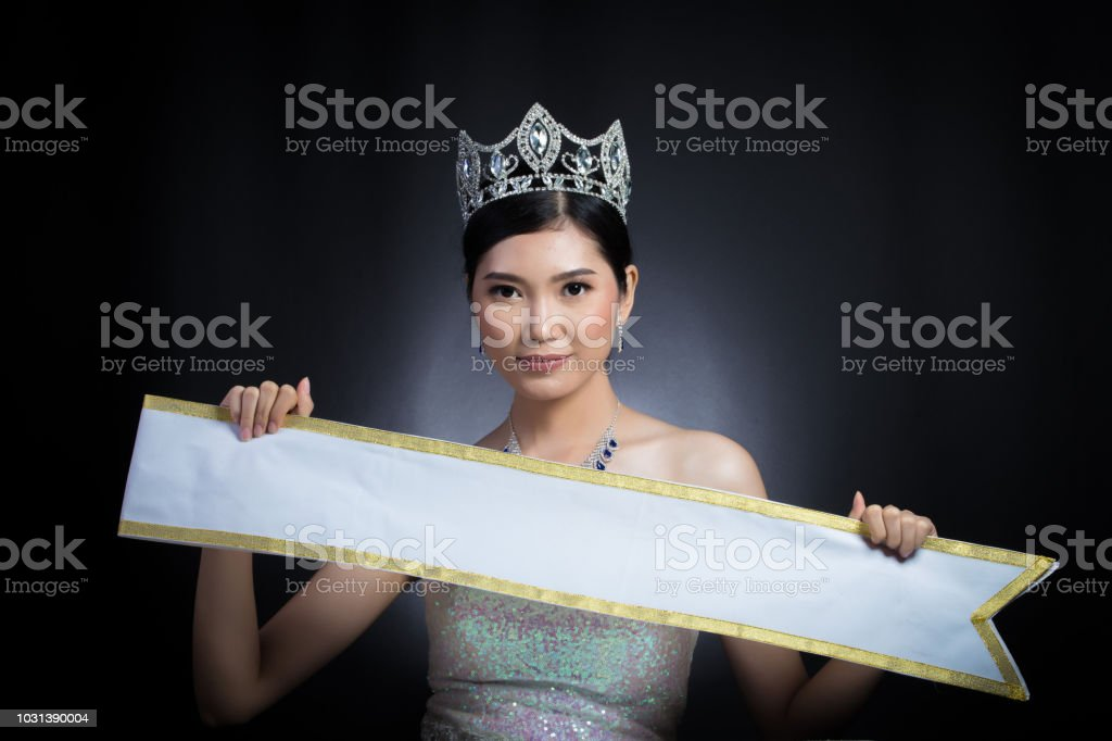Asian Woman black hair style holding present Empty sash ribbon for country name copy space stock photo