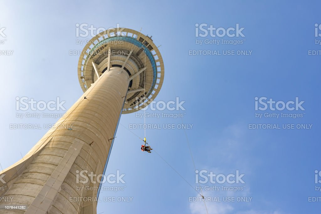 Asian Woman Bungy Jumping from Macau Skytower stock photo
