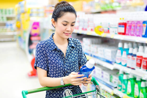 Asian woman buys mouthwash stock photo
