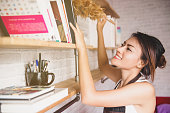 istock Asian woman cleaning house happy mood,focus on face 1191539320