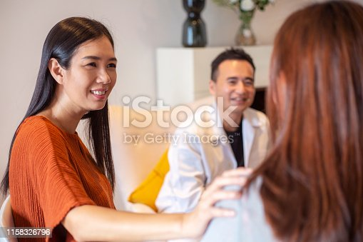 956725746 istock photo Asian woman comforts friend in support group 1158326796