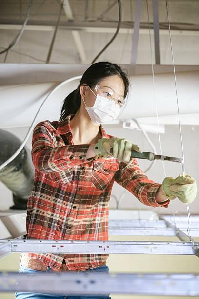 asian woman construction worker - kvinna ventilationssystem bildbanksfoton och bilder