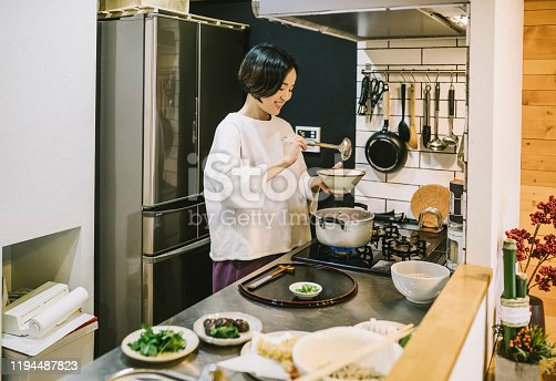 istock Asian Woman cooking in the kitchen 1194487823
