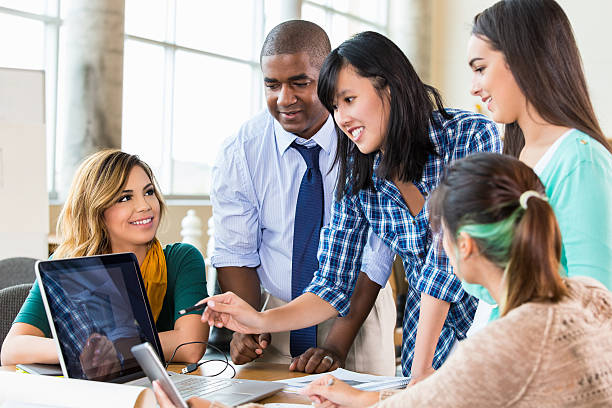 Asian woman discusses design with colleages in modern design office stock photo