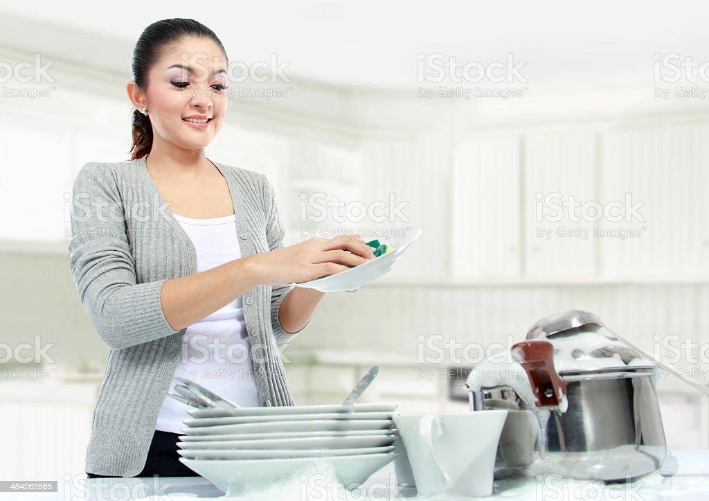 asian woman doing house work stock photo