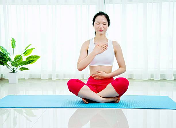 Asian woman doing yoga meditation stock photo