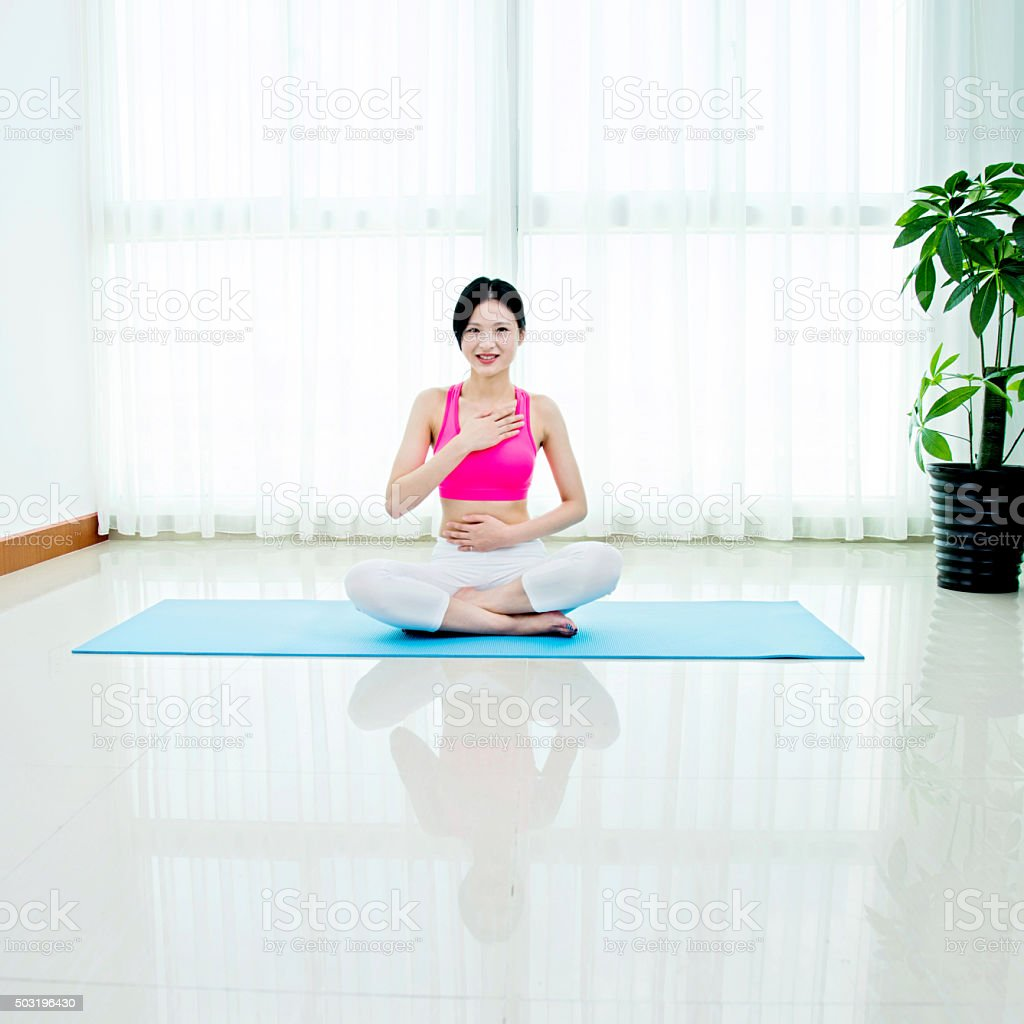 Asian woman doing yoga meditation stock photo