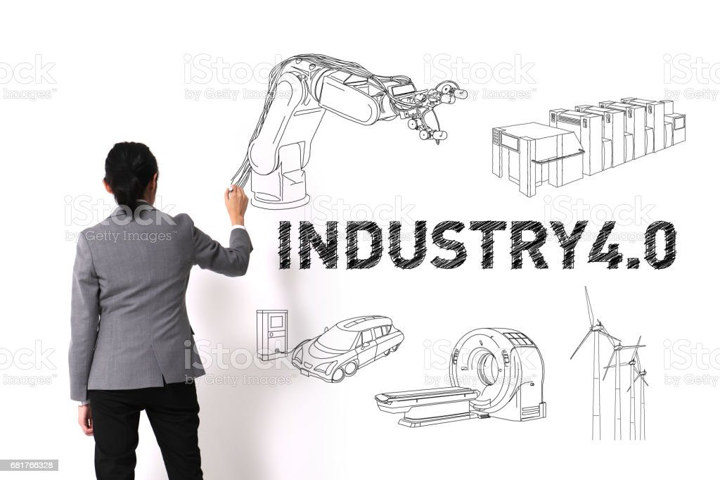 asian woman drawing illustrations of Industry4.0 on white wall stock photo