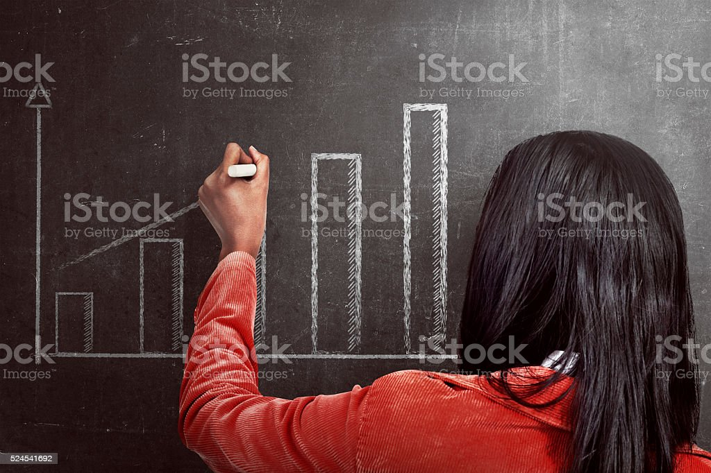 Asian woman drawing increasing chart on the blackboard stock photo