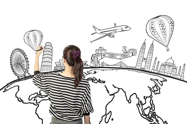 asian woman drawing or writing dream travel around the world圖像檔