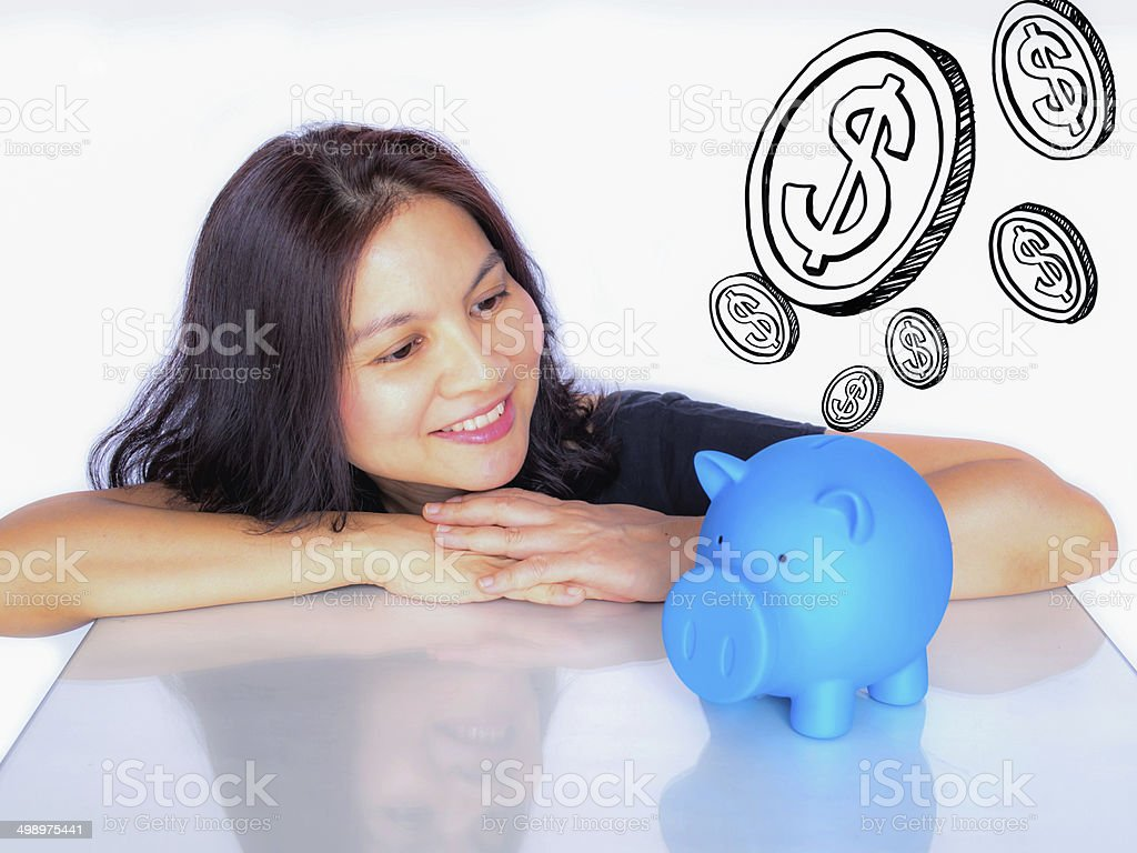 Asian woman dreaming about  money with piggy bank royalty-free stock photo