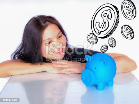481974106istockphoto Asian woman dreaming about  money with piggy bank 498975441