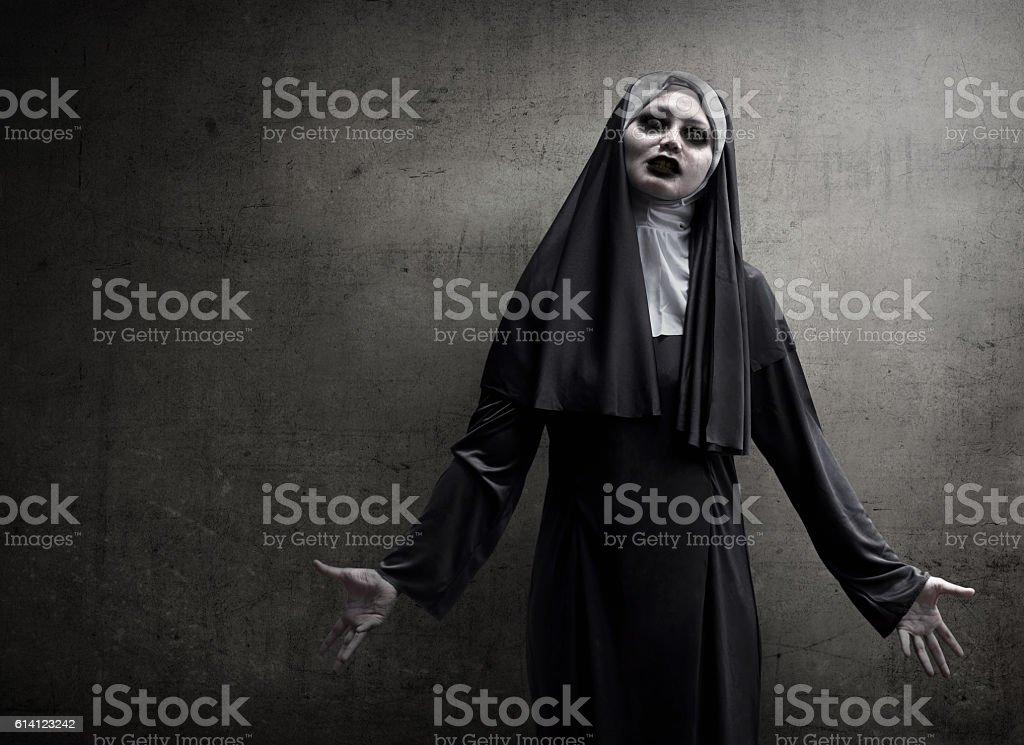 Asian woman dressed in evil nun stock photo