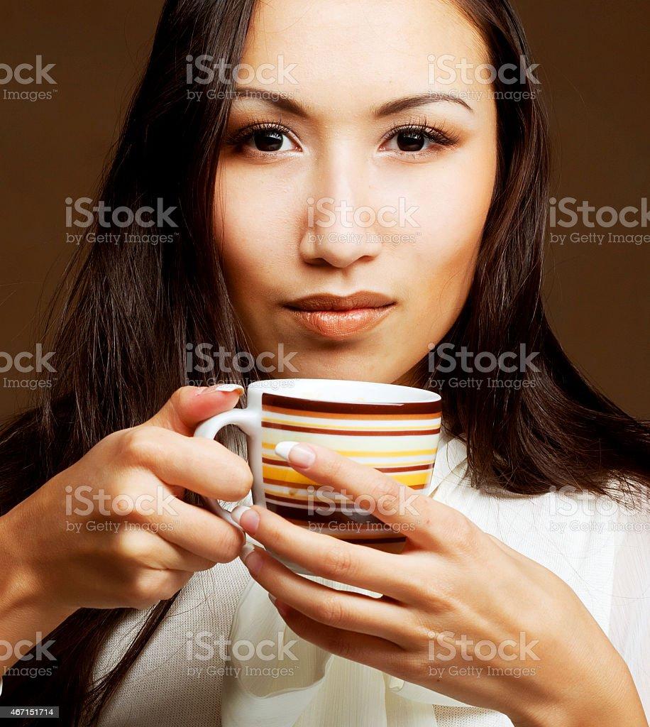 asian woman drinking coffee or tea stock photo