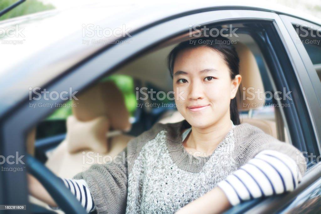 Asian woman driving stock photo