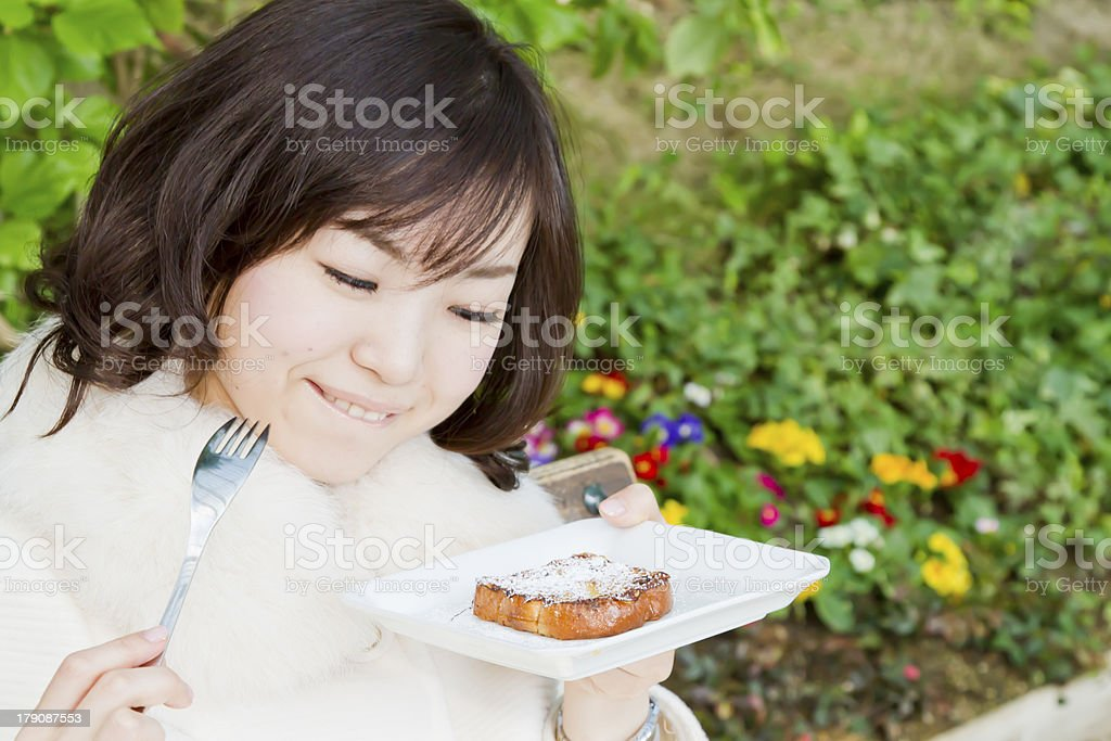 Asian Woman Eating French Toast royalty-free stock photo