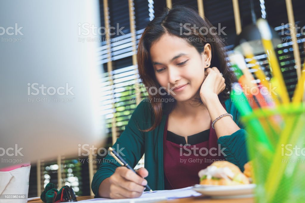 asian woman enjoy with her job stock photo