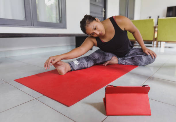 Asian woman exercise flexibility from online course stock photo