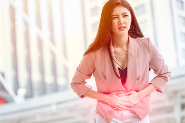 asian woman front stomach painful sign of ovarian endometriosis and chocolate cyst syndrome. - cyst stock pictures, royalty-free photos & images