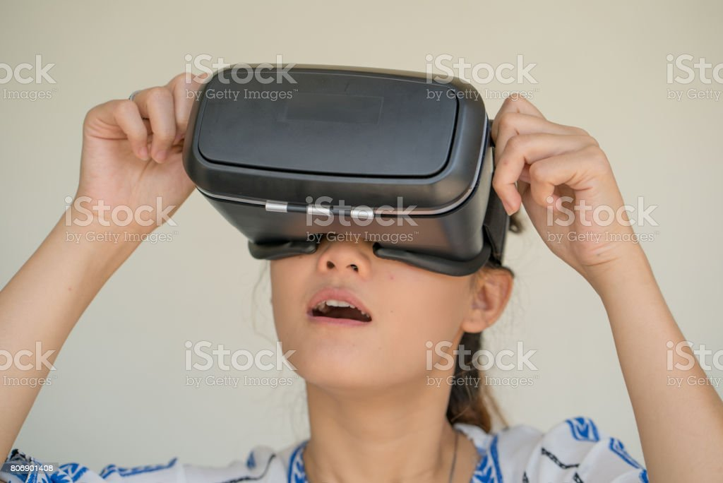 13c7a95a2022 Asian woman getting experience using VR-headset glasses of virtual reality.  royalty-free