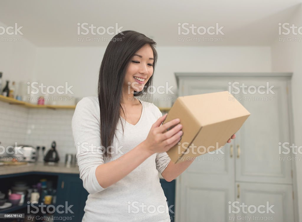 Asian woman getting the mail at home stock photo