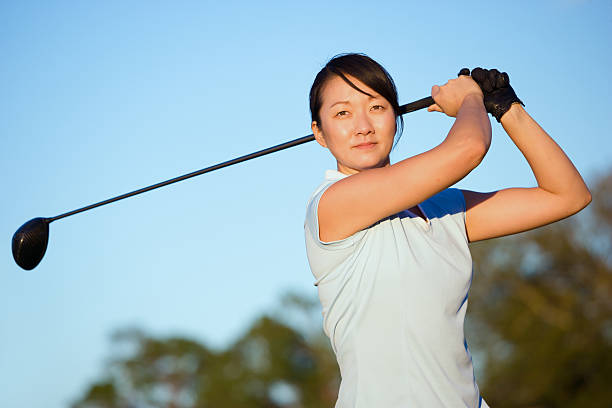 asian woman golf swing - female golfer stock photos and pictures