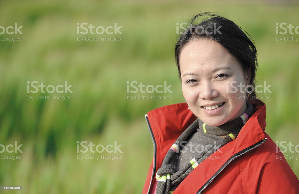 asian woman grass in red royalty-free stock photo