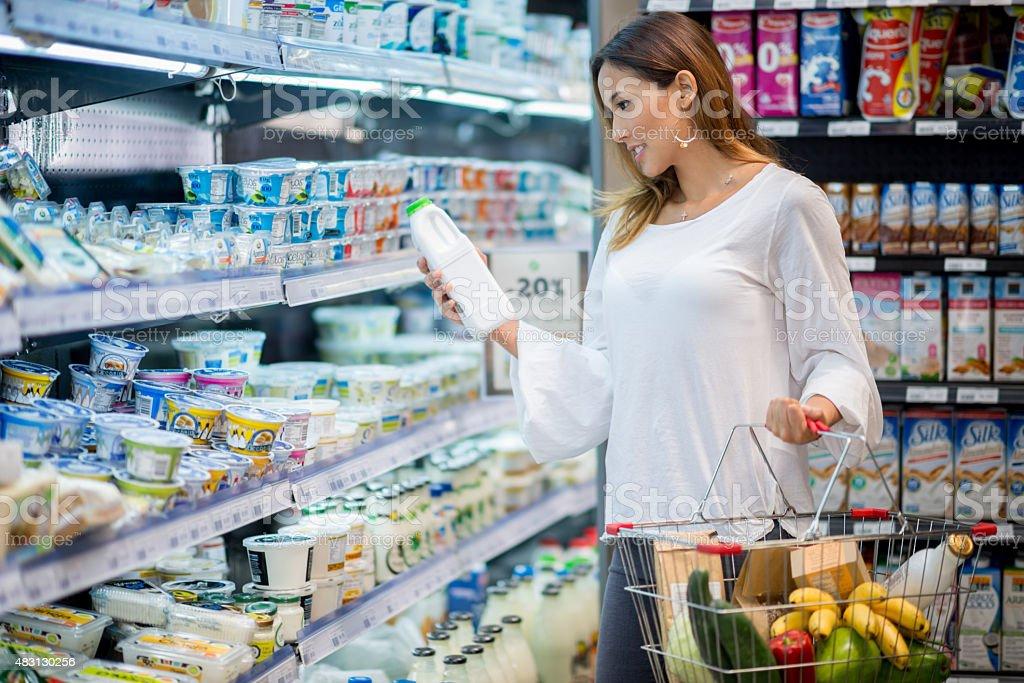 Asian woman grocery shopping stock photo