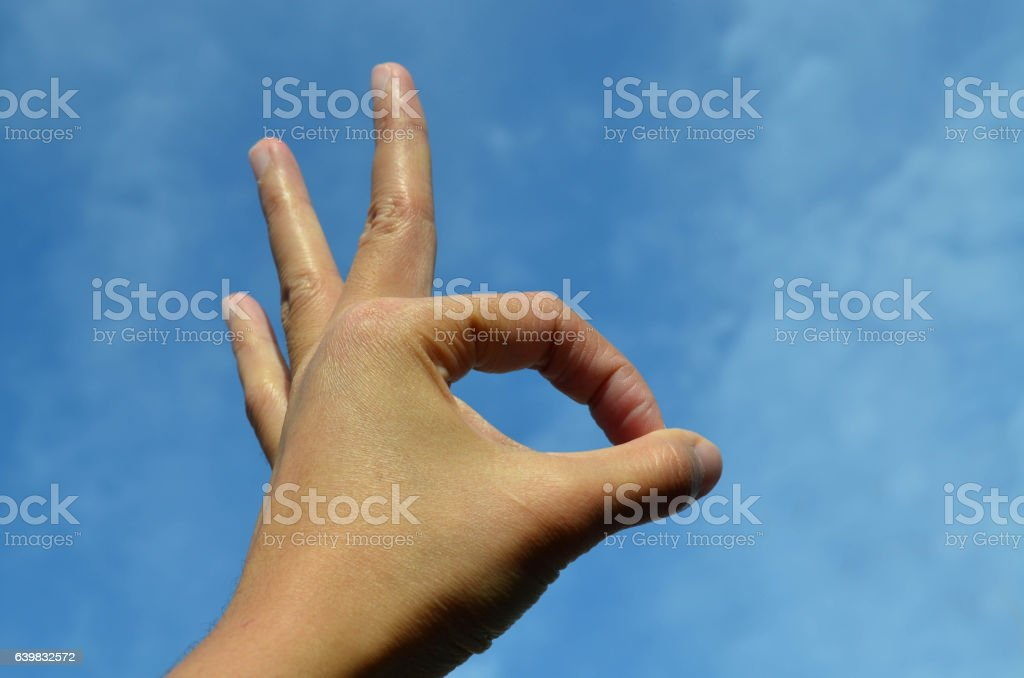 Asian woman hand showing ok sign stock photo