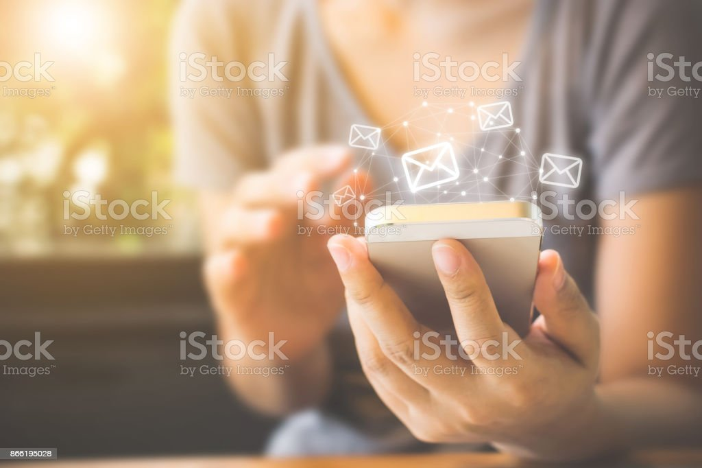 Asian woman hand using mobile phone with e-mail application, Concept email and newsletter stock photo