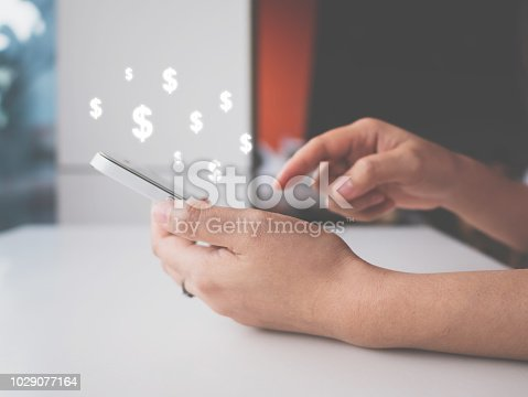 istock Asian woman hand using mobile phone with online transaction application, Concept ecommerce and internet online investment 1029077164