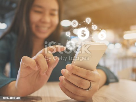 Asian woman hand using mobile phone with online transaction application, Concept financial technology (fin-tech)