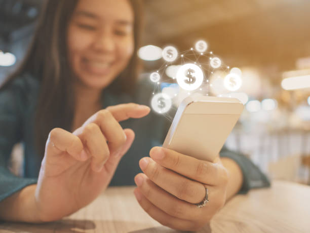 Asian woman hand using mobile phone with online transaction application, Concept financial technology (fintech) Asian woman hand using mobile phone with online transaction application, Concept financial technology (fin-tech) wages stock pictures, royalty-free photos & images