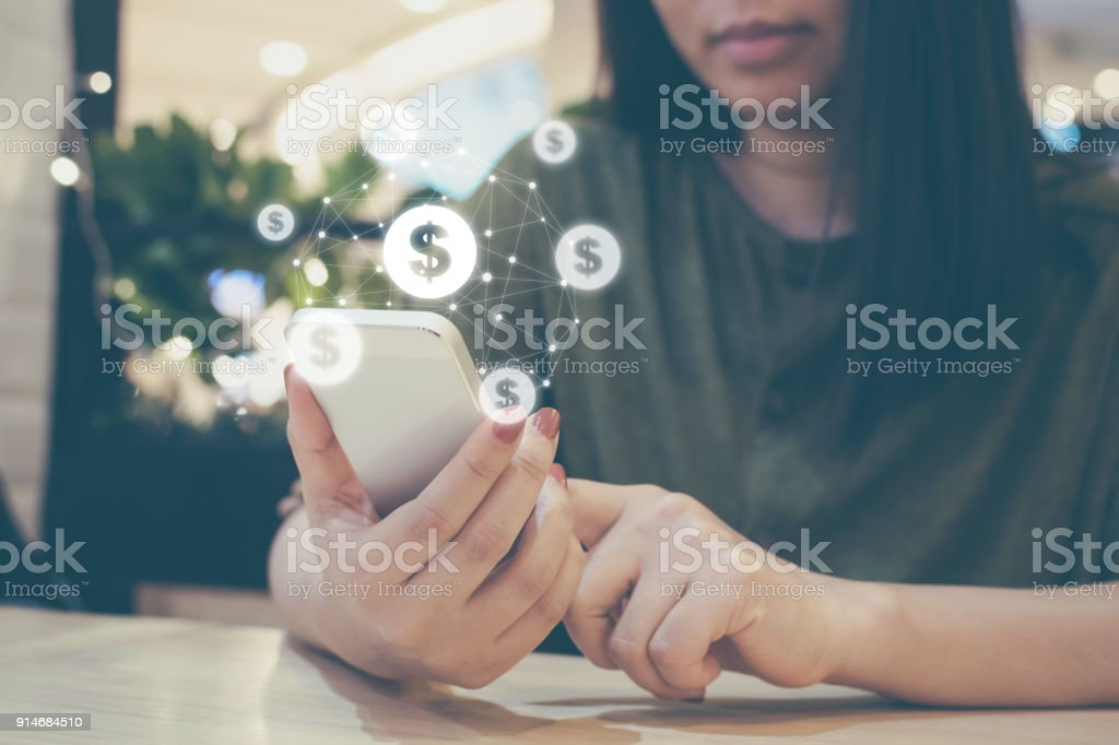 Asian woman hand using mobile phone with online transaction application, Concept ecommerce and internet online investment stock photo