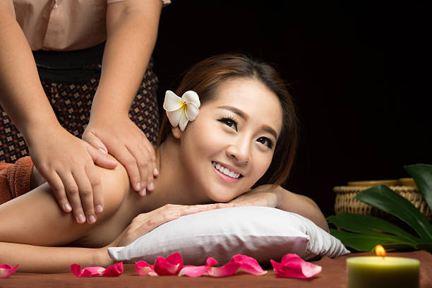 asian woman having massage and spa salon beauty treatment concep - thai massage stock photos and pictures