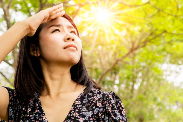 Asian woman having problem sunburn ,melasma, freckles on skin, hand cover her face to protect UV sunlight Asian woman having problem sunburn ,melasma, freckles on skin, hand cover her face to protect UV sunlight dark spots face stock pictures, royalty-free photos & images