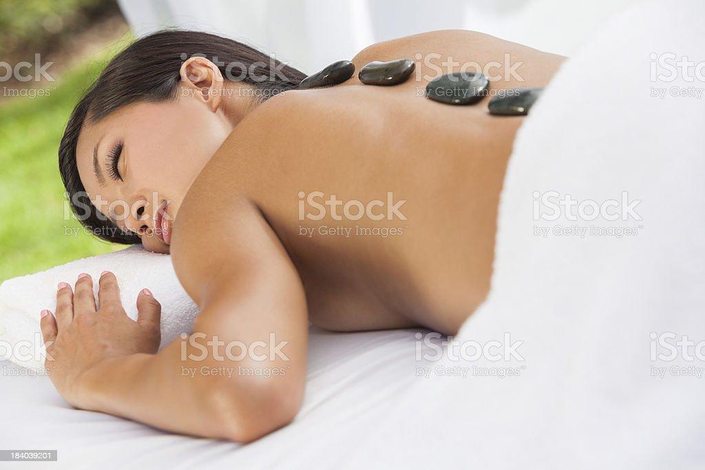 Asian Woman Health Spa Hot Stone Treatment Massage royalty-free stock photo