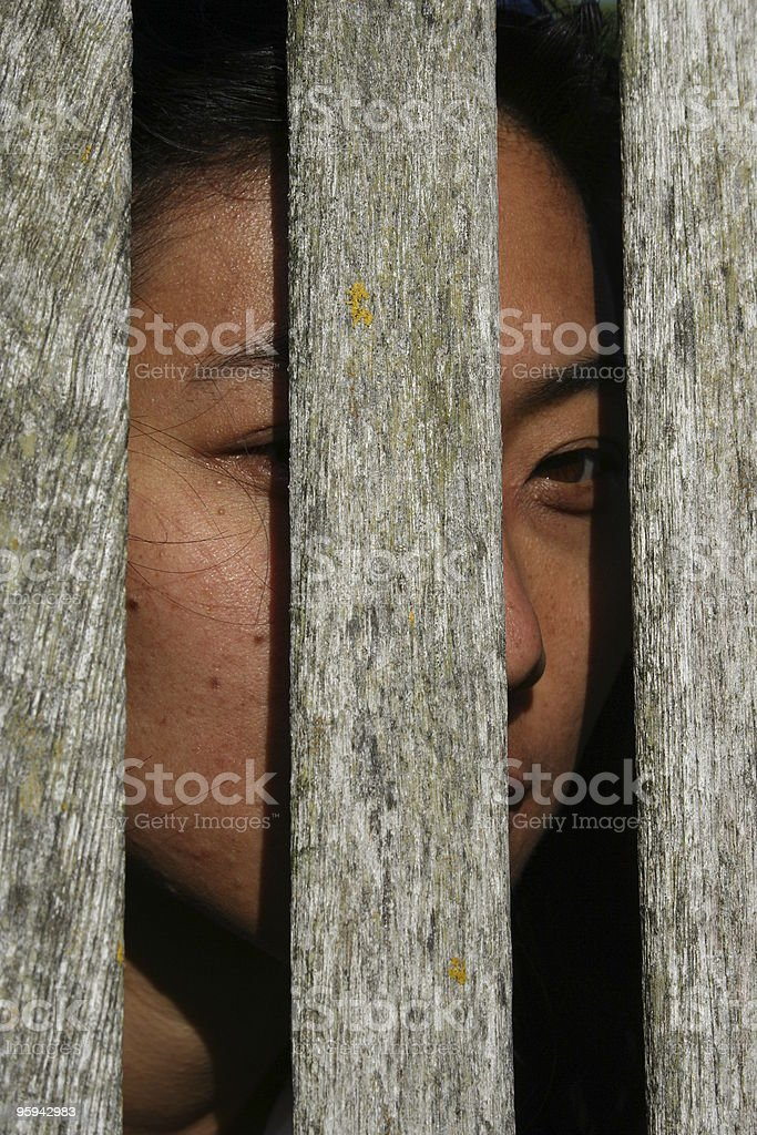 Asian Woman Hiding in Fear royalty-free stock photo