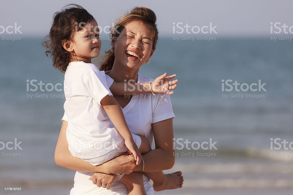 Asian woman hold the boy on beach royalty-free stock photo