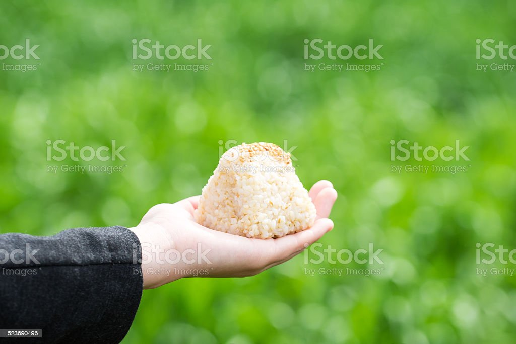 Asian woman holding a rice ball stock photo