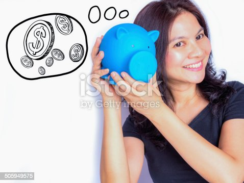 481974106istockphoto Asian woman holding piggy bank, thinking about her money 505949575