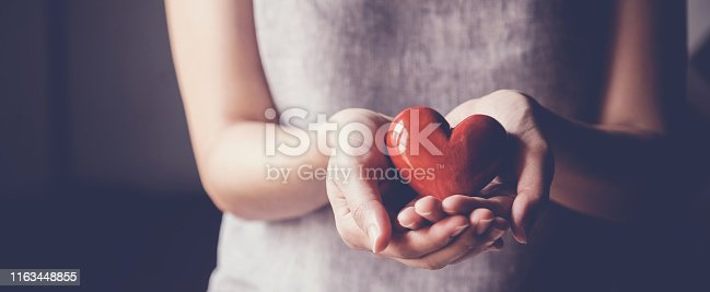 istock Asian woman holding red heart, health insurance, donation charity concept 1163448855