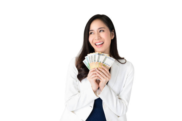 Asian woman holding South Korean won money in hands stock photo
