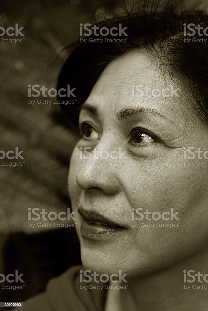 Asian woman in her 60's royalty-free stock photo
