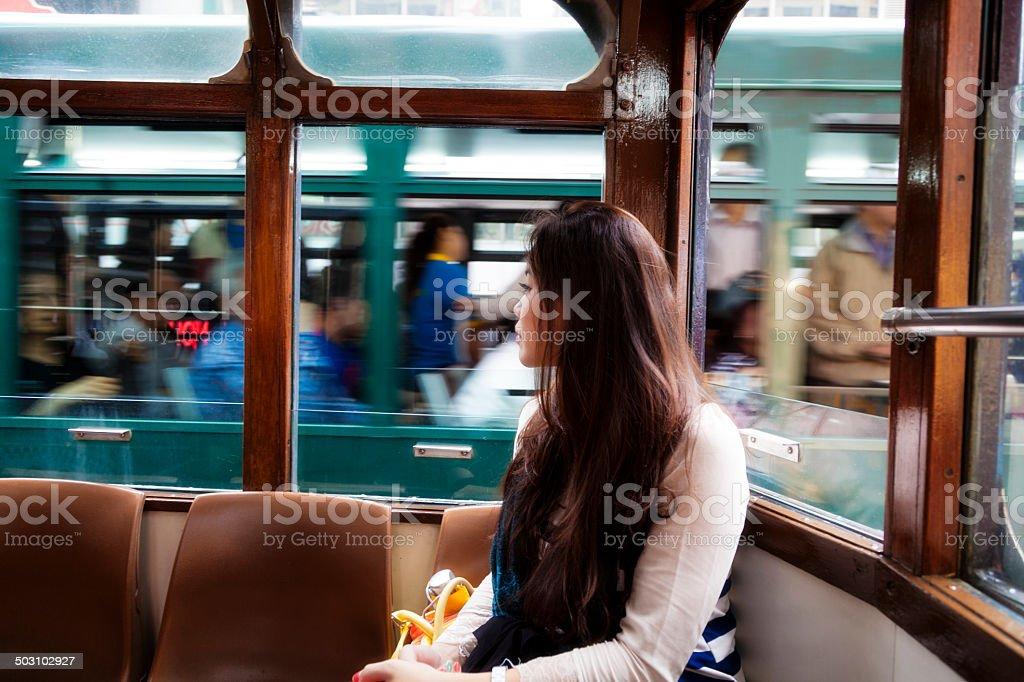 Asian woman in Hong Kong tram foto