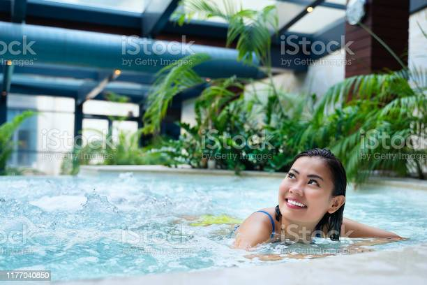 Asian Woman In Indoor Hot Tub Swimming Pool Enjoying Holiday At Hotel Stock Photo Download Image Now Istock