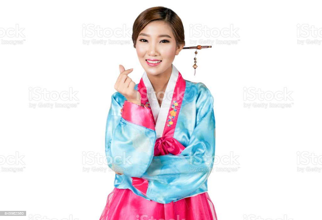 Asian woman in Korean Traditional Dress making mini hearth fingers on white background isolated with clipping path. stock photo