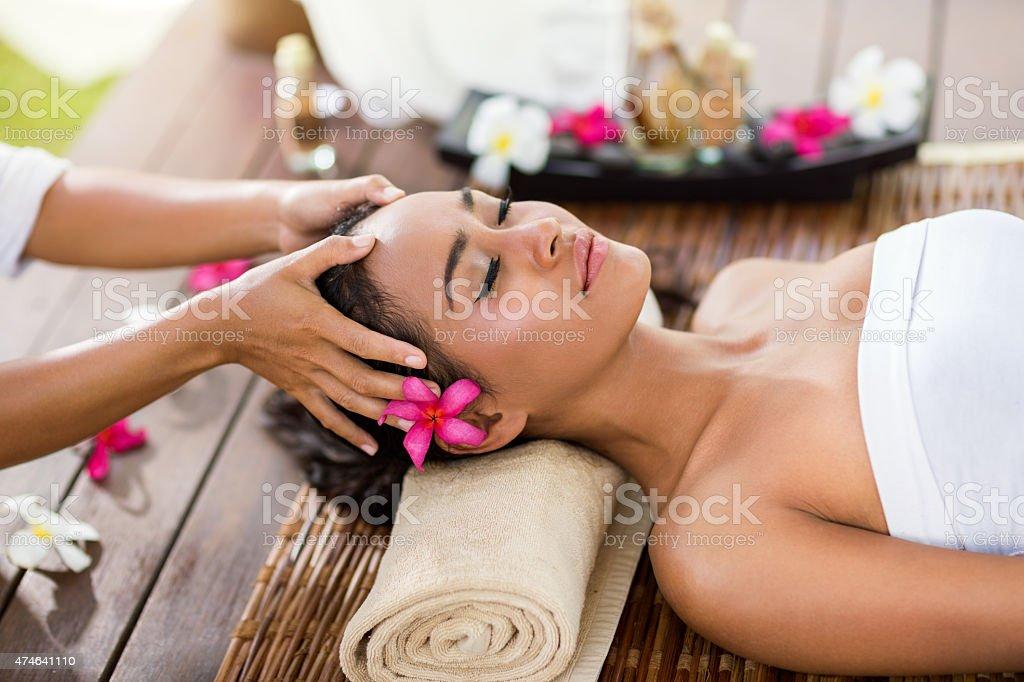 Asian woman in spa salon, massage the head stock photo