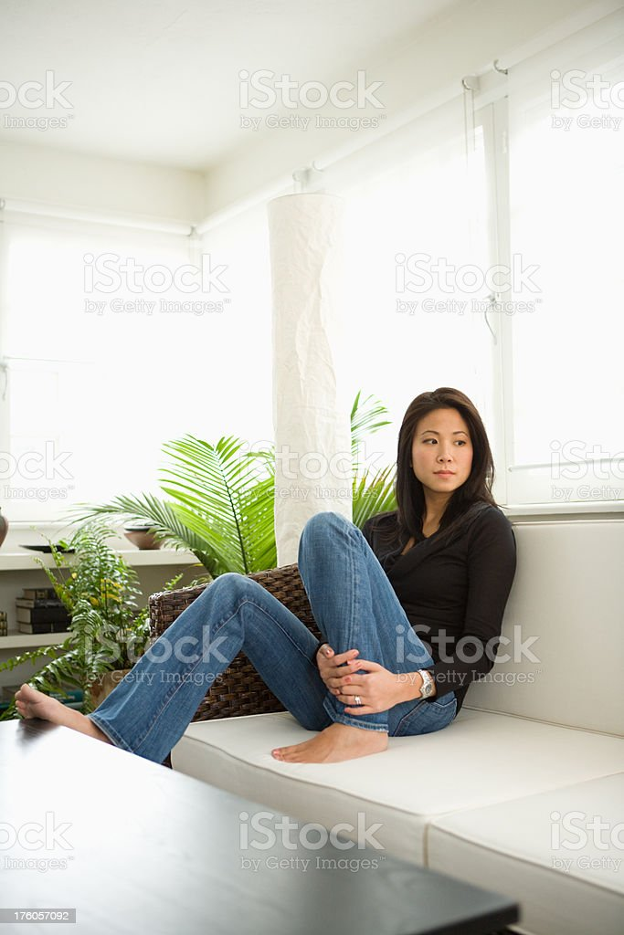 asian woman in sun room royalty-free stock photo