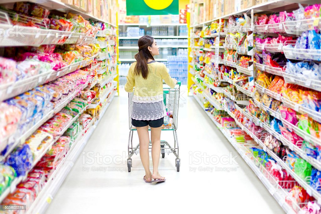 Asian woman in supermarket stock photo